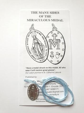 miraculous medal on blue string